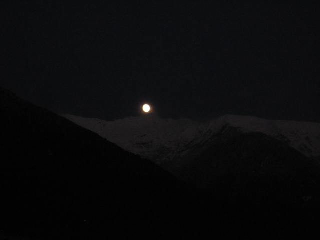 Full moon rising over the Alps.