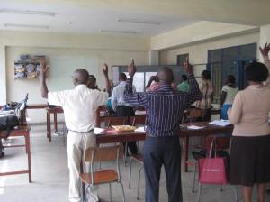 Another teacher leading a praise song at the seminar session--thanking God!