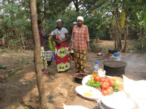 Women cooking a mid-day meal.