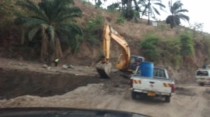 The aftermath of a mudslide--road closures and rebuilding.