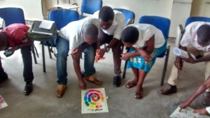Students playing a board game for first time.